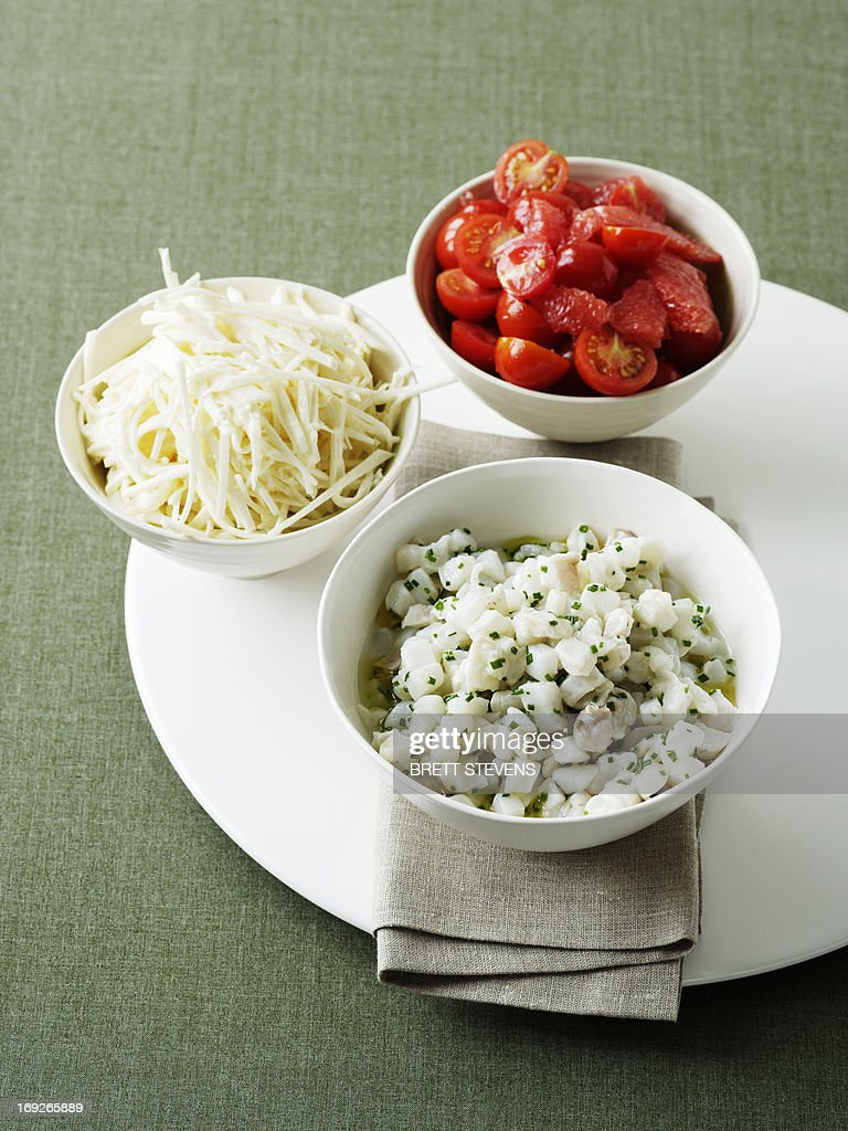 Bowls of cheese and tomatoes