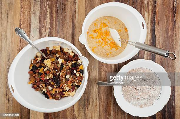 Bowls of Christmas fruit cake ingredient on table