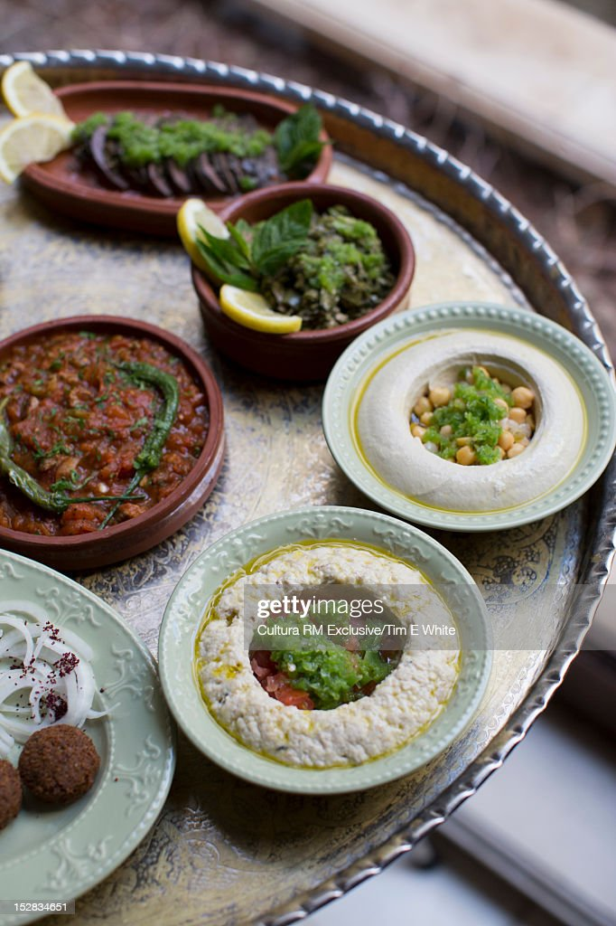 Bowls of dips on serving tray : Stock Photo