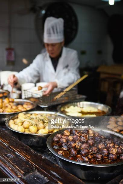 Bowls of fresh street food on food stall, Ningbo, Zhejiang, China