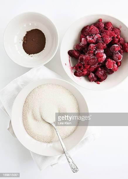Bowls of fruit, sugar and cocoa