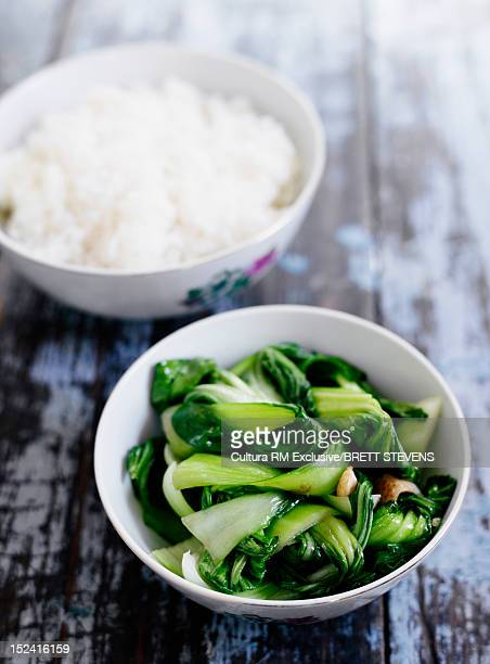 Bowls of greens and rice