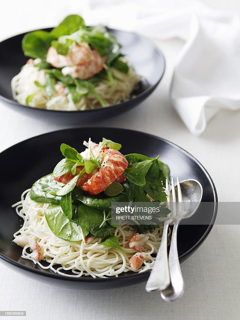 Bowls of marron salad with pasta : Stock Photo