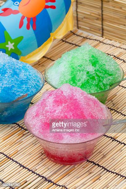 Bowls of shaved ice with syrup