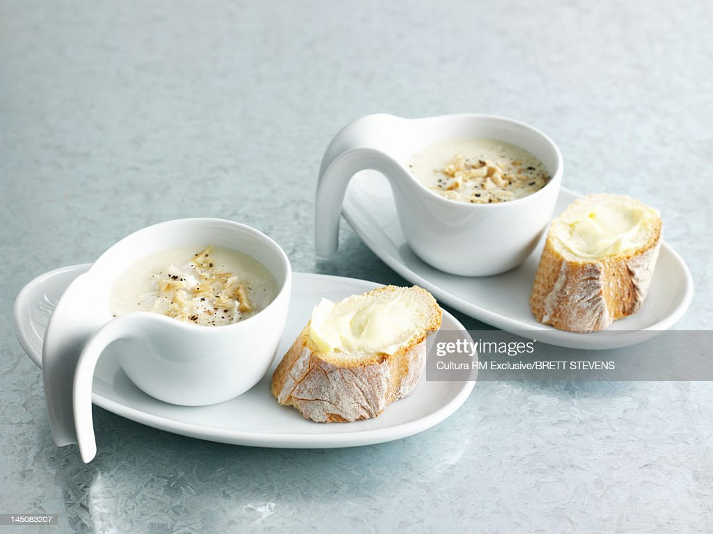 Bowls of soup with bread