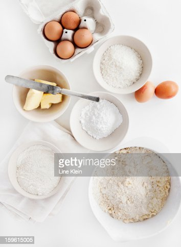 Bowls of sugar, flour, eggs, butter