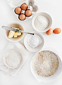 Bowls of sugar, flour, eggs, butter