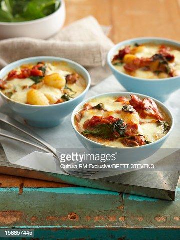 Bowls of tomato and bacon gnocchi : Stock Photo