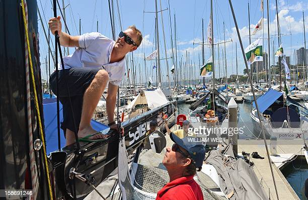 Bowman Craig Duffield and helmsman Mark Vickers inspect the mast of Brisbane yacht Ocean Affinity as teams prepare for the gruelling Sydney to Hobart...