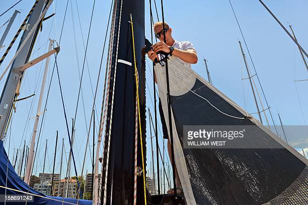 Bowman Craig Duffield works on the mainsail on Brisbane yacht Ocean Affinity as teams prepare for the gruelling Sydney to Hobart yacht race which...