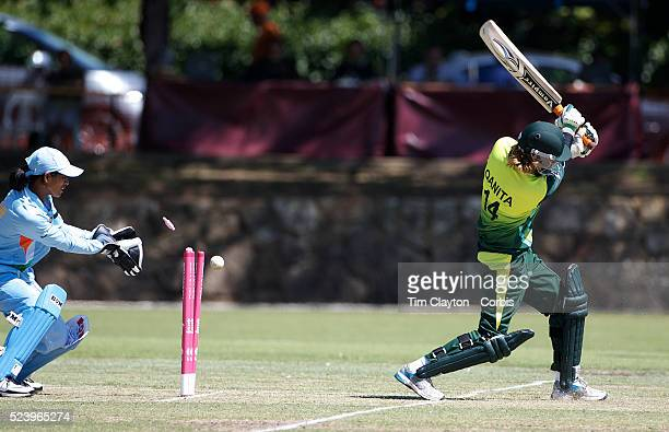 Qaniti Jalil of Pakistan is bowled by Priyanka Roy of India as wicket keeper Anagha Deshpande celebrates as India and Pakistan compete in the first...