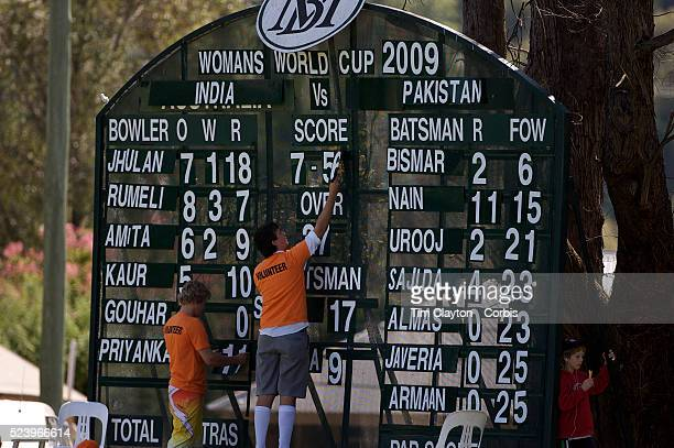 Scoreboard attendants adjust the score as India and Pakistan compete in the first match of group B of the ICC Women's World Cup Cricket at the...