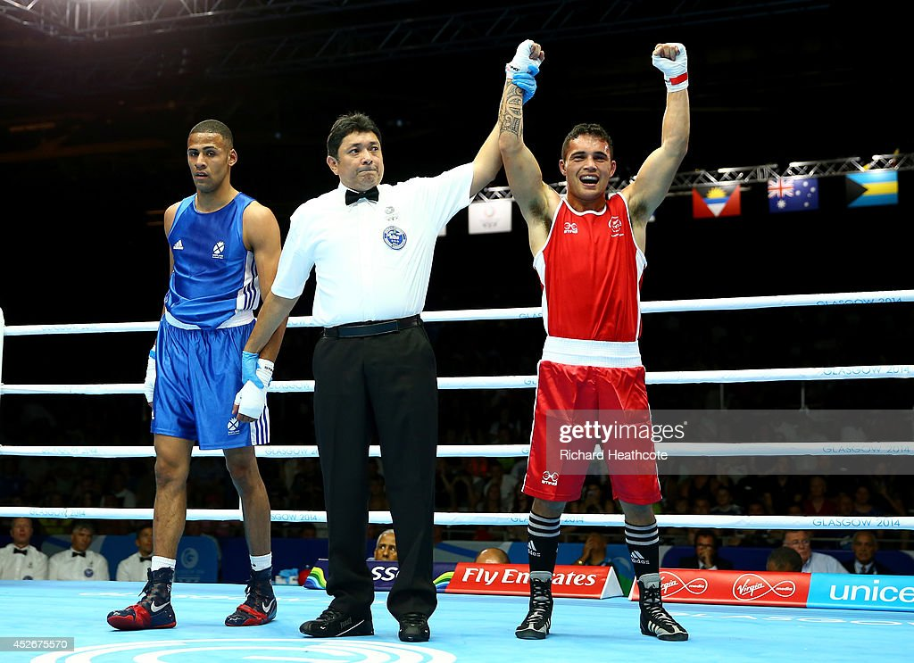 Bowyn Morgan of New Zealand (red) in action against Lewis Benson of Scotland in the Men's Welter 69kg preliminaries at Scottish Exhibition And Conference Centre during day two of the Glasgow 2014 Commonwealth Games on July 25, 2014 in Glasgow, United Kingdom.