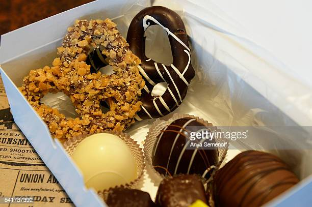 A box full of chocolates and treats sits on the counter at PS Sweet Shoppe on June 8 in Lakewood Colorado PJ Sexton opened PS Sweet Shoppe at the end...