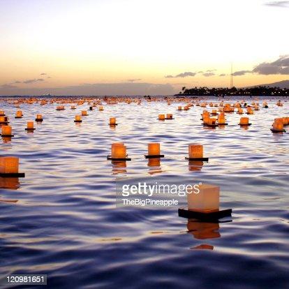 Box lanterns floating in ocean