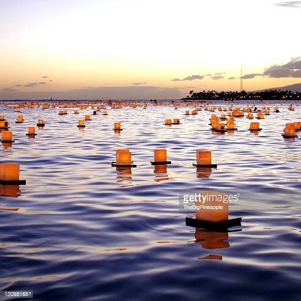 Box lanterns floating in ocean