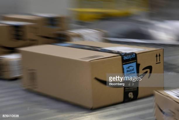 A box moves along a conveyor belt at the Amazoncom fulfillment center in Kenosha Wisconsin US on Tuesday Aug 1 2017 Amazoncom Inc held a giant job...