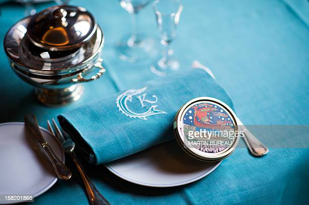 A box of caviar is displayed in a plate at the shop of Kaspia Caviar on December 11 2012 in Paris AFP PHOTO MARTIN BUREAU