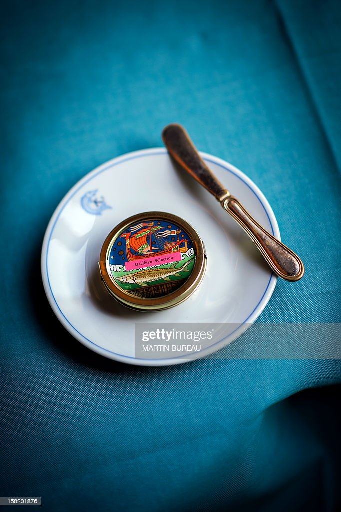A box of caviar (royal beluga) is displayed in a plate at the shop of Kaspia Caviar, on December 11, 2012 in Paris. AFP PHOTO MARTIN BUREAU