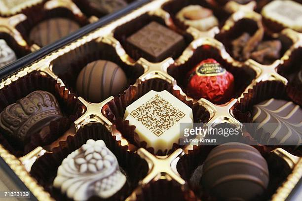 A box of chocolates contains a piece decorated with a URL written in twodimensional code on June 29 2006 in Tokyo Japan The chocolate is codeveloped...