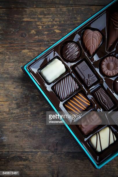 Box of chocolates on dark wood