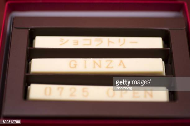 A box of customizable 'Sublime Original Message' KitKat bars is arranged for a photograph during a media preview of the KitKat Chocolatory Ginza...