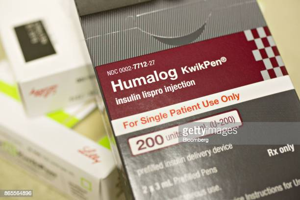 A box of Eli Lilly Co Humalog brand kwikpen insulin delivery devices is arranged for a photograph at a pharmacy in Princeton Illinois US on Monday...