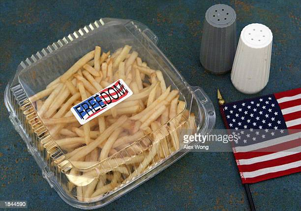 A box of 'Freedom Fries' is seen with an American flag at a cafeteria in the US Capitol building on Capitol Hill March 12 2003 in Washington DC With...