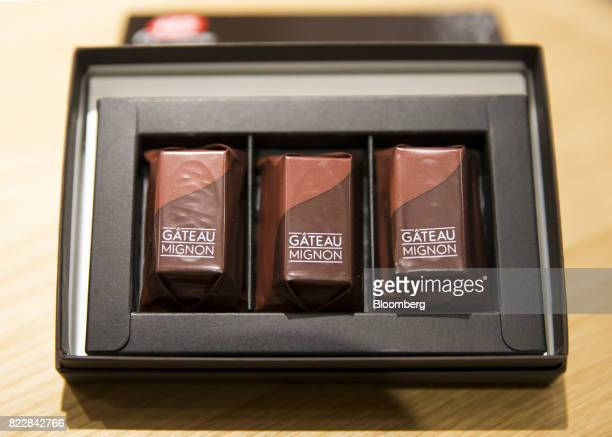A box of Gateau Mignon KitKat is displayed during a media preview of the KitKat Chocolatory Ginza store operated by Nestle SA in Tokyo Japan on...