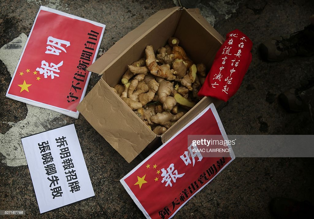 A box of ginger -- held by protesters to represent courage and a play on words of Keung surname -- sits on the ground after a rally organised by Journalist groups to protest the sacking of Ming Pao's Executive Chief Editor Keung Kwok-yuen in Hong Kong on May 2, 2016 / AFP / ISAAC