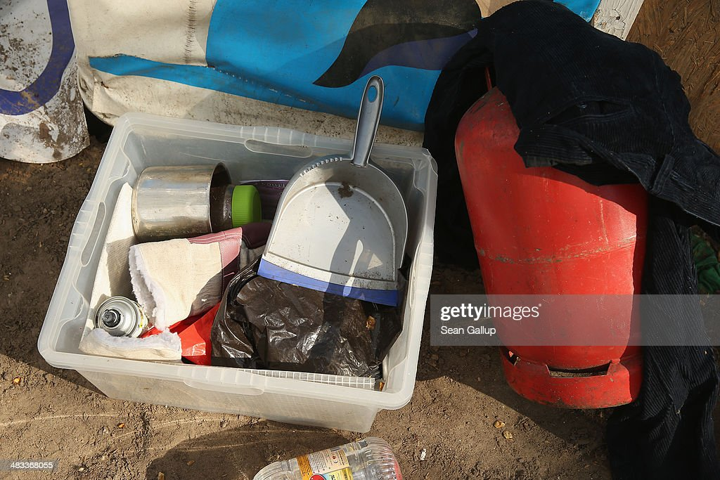 A box of household items and a gas canister are among detritus lying on the ground at the former temporary refugee camp at Oranienplatz in Kreuzberg district after riot police sealed it off on April 8, 2014 in Berlin, Germany. Several hundred riot police sealed off the square after, according to an eyewitness, violence broke out between refugees who had accepted a deal by the city to leave the camp and a small number who insisted on staying. Refugees, many of them from Africa who came to Germany via Lampedusa, began dismantling their shelters today after many of them agreed to a deal with city authorities to move to a renovated hostel. Not all of the several hundred refugees, some of whom have been living at the Oranienplatz camp almost a year, have agreed to the deal, and while some said they will go elsewhere, some insisted they will stay, despite a city order to vacate.