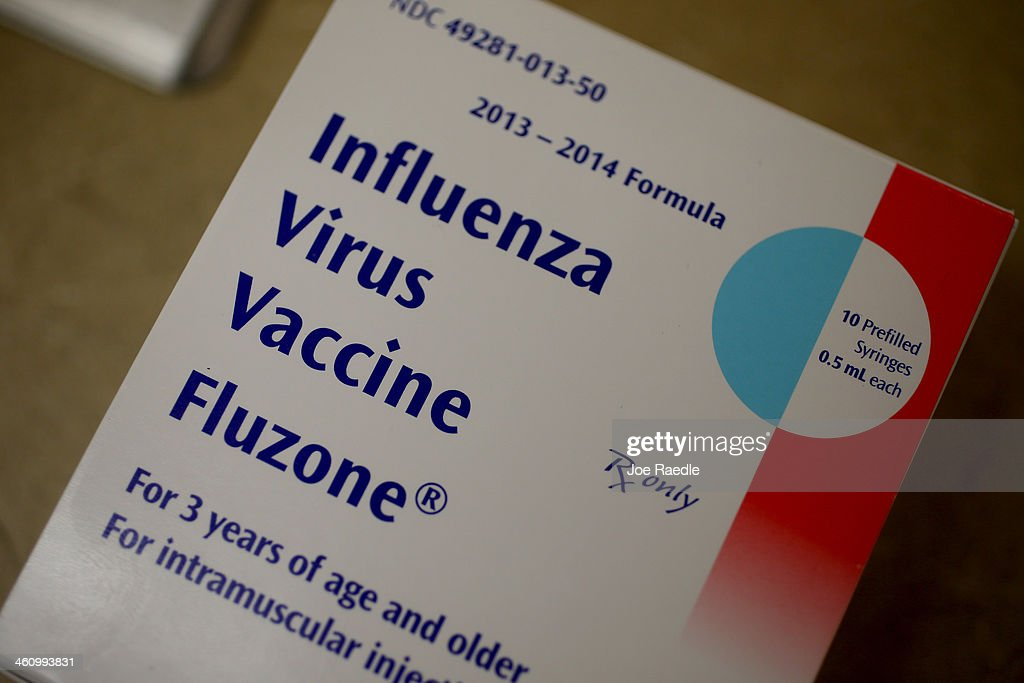 A box of influenza vaccine shots is seen in the MinuteClinic at the CVS/pharmacy on January 6 2014 in Fort Lauderdale Florida The 20132014 influenza...
