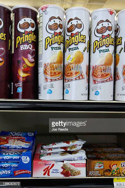 A box of Kellogg brand Special K bars sits below packages of Pringles chips at a convience store on February 15 2012 in Miami Florida Procter Gamble...