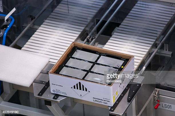 A box of lithiumion rechargable battery cells manufactured by Samsung SDI Co sit on the production line at the Bayerische Motoren Werke AG automobile...