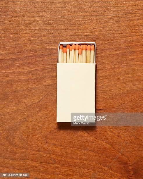 Box of matches on wooden surface, overhead view
