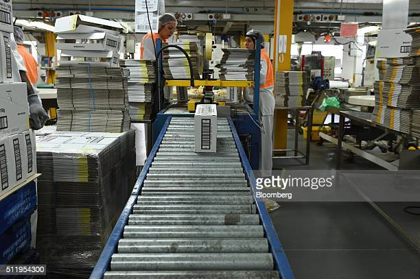 A box of nuts moves along a conveyor in the packaging area at a Select Harvests Ltd processing facility in Melbourne Australia on Monday Feb 22 2016...
