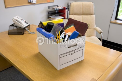 Box Of Office Supplies On Desk Stock Photo