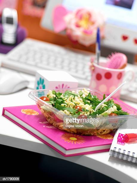 Box of Pasta Salad on a Desk in an Office