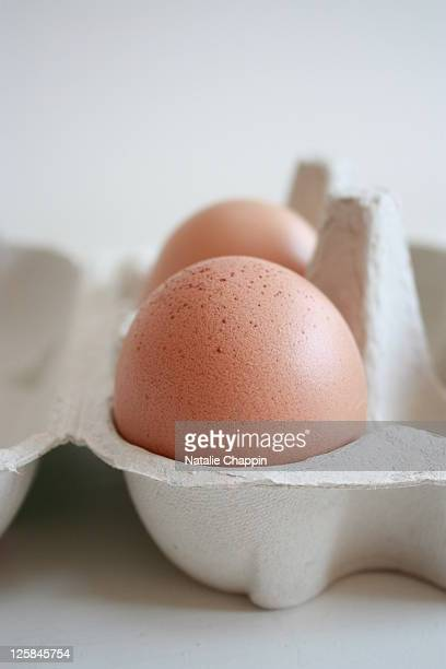 Box of pink eggs