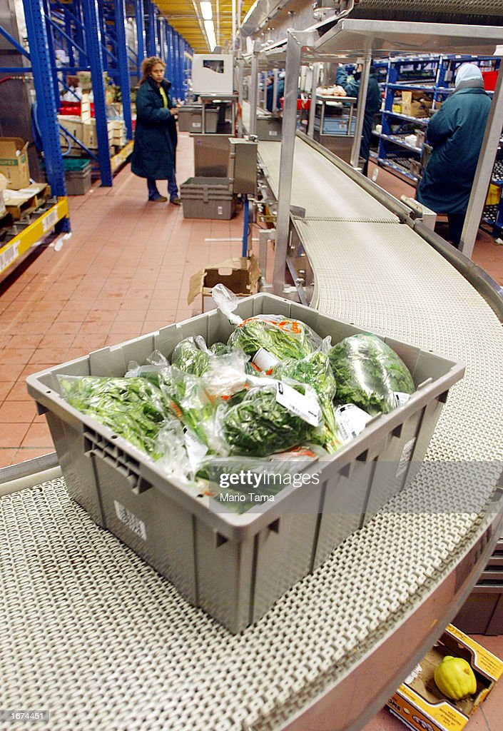 A box of produce moves along a conveyer belt in the new FreshDirect online grocery service warehouse December 5, 2002 in New York City. The state-of-the-art 300,000 square foot facility houses 200 workers with a fleet of 23 trucks making deliveries based on 2-hour appointment slots to New Yorkers. FreshDirect charges a flat $3.95 delivery fee. In an era of failed Web businesses, FreshDirect owner Joe Fedele says he hopes to turn a profit in six months.