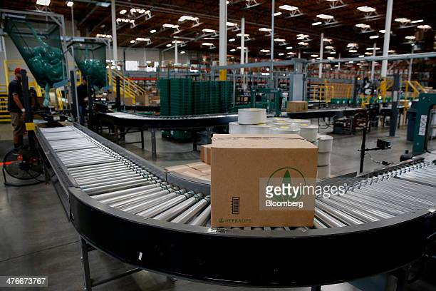 A box of products moves on a conveyor belt to be shipped at the Herbalife Ltd Los Angeles distribution center in Carson California US on Tuesday...