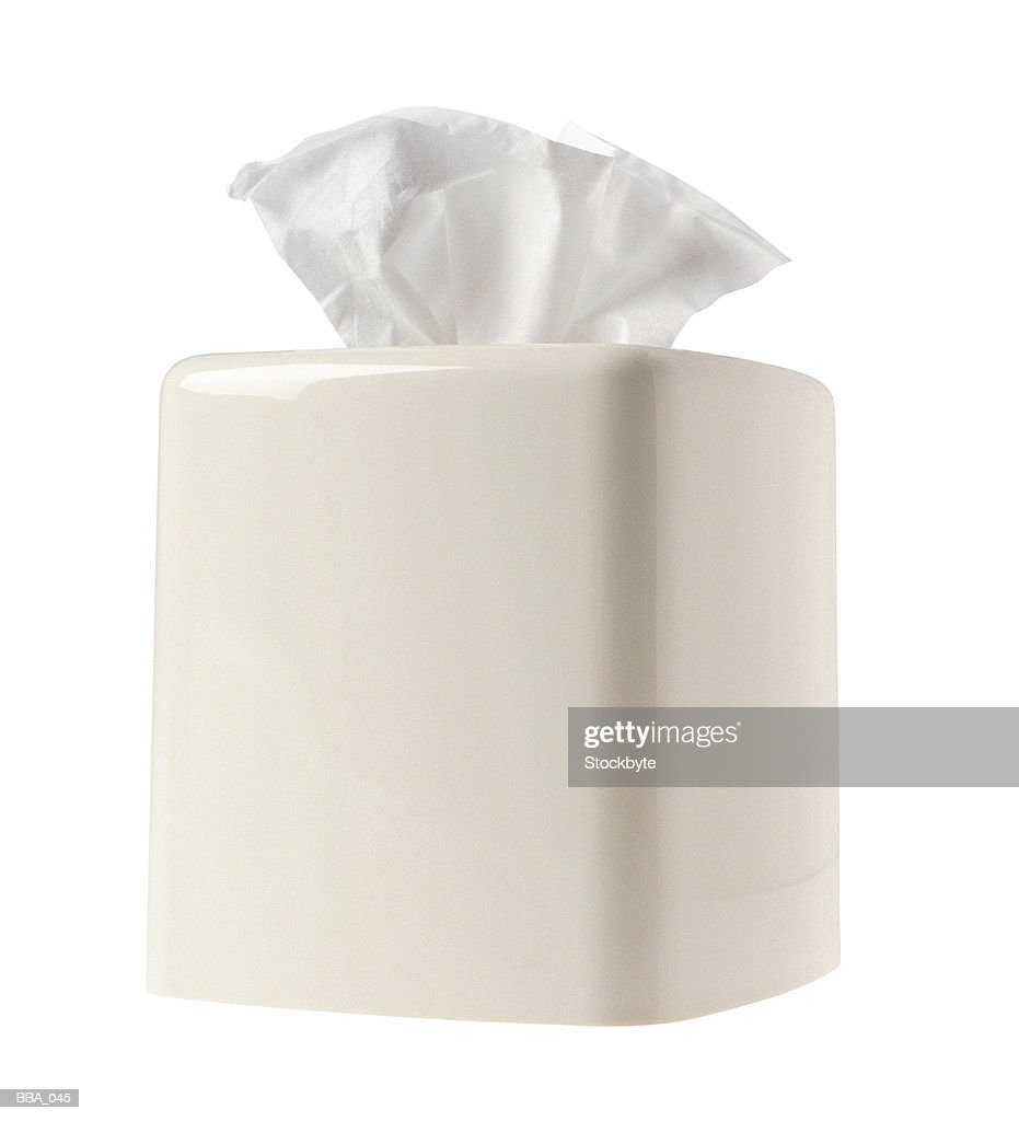 Box of tissues in ceramic cover