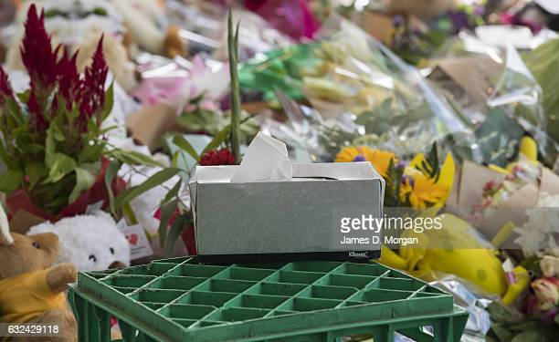 A box of tissues sits on a milk crate next to flowers and messages of condelence outside a shop on January 23 2017 in Melbourne Australia Five people...