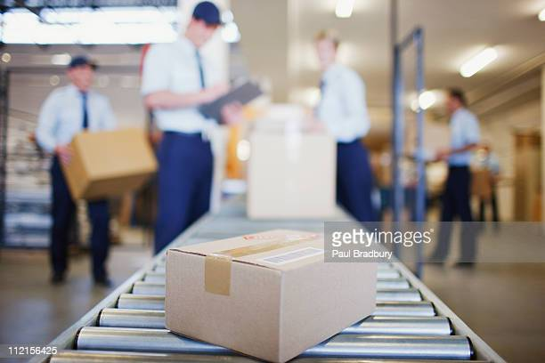 Box on conveyor belt in shipping area