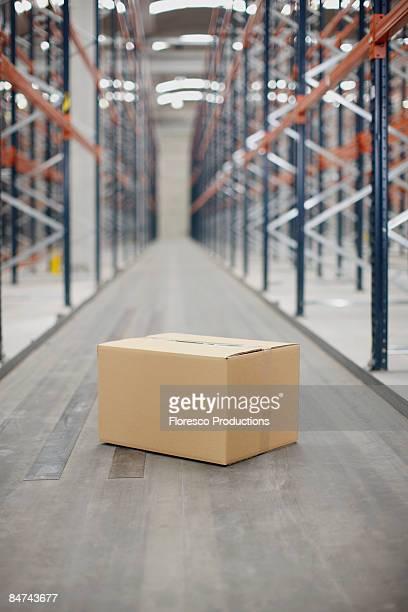 Box on warehouse floor