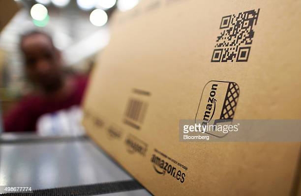 A box sits in a packing station at the Amazoncom Inc fulfillment center in Hemel Hempstead UK on Wednesday Nov 25 2015 WalMart and Amazon's toy...