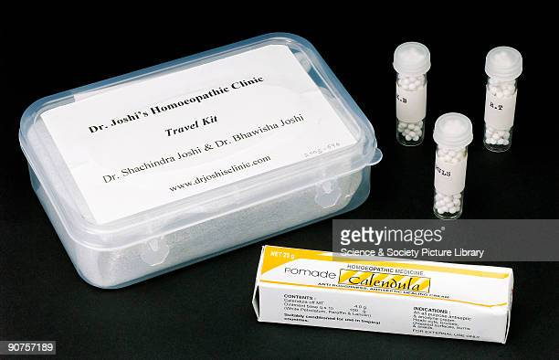 A box with ten vials of different homeopathic pills and a box containing a tube of Calendula homeopathic antiseptic cream produced for Drs Shachindra...