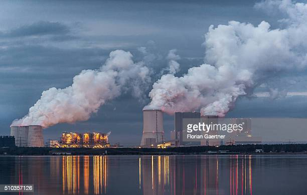 Boxberg Power Station is reflected in the lake 'Baerwalder See' in Klitten on February 14 2016 This lignitefired power station is the fourth largest...