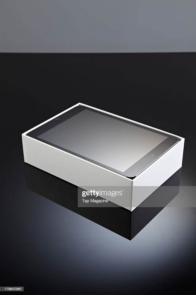 A boxed Apple iPad Mini tablet computer photographed during a studio shoot for Tap Magazine, November 29, 2012.