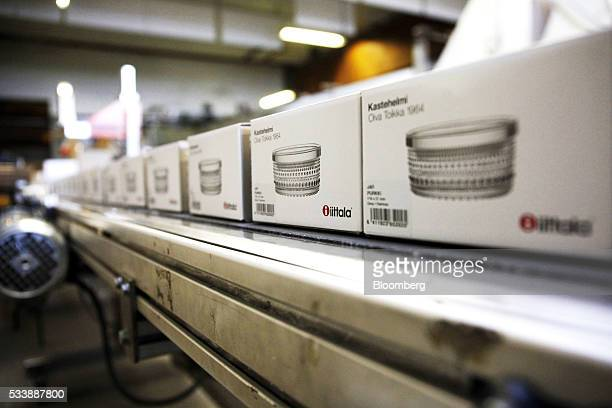 Boxed Kastehelmi style glass bowls move along a conveyor belt in preparation for shipping at the Iittala Oyj glass factory operated by Fiskars Oyj in...